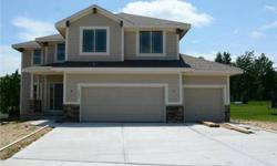 """The """"springbrook"""" plan by sallee homes, has a large open living room with big picture windows and fireplace. Tina Branine is showing this 4 bedrooms / 2.5 bathroom property in Blue Springs. Call (913) 963-3444 to arrange a viewing."""