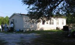 Double wide mobile home on over 4 acres of land in Frost Proof. There currently is no access to subject property. Buyer will need to have driveway cut in to access home. This is a 3 bedroom and 2 bath unit located on 4 acres of land zoned agriculture.
