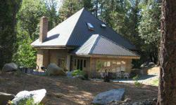 This is a beautiful, custom built home bordering Rush Creek in Lewiston. The setting is among huge tall trees and is surrounded by granite boulders and is absolutely gorgeous as well as very private. The property borders Rush Creek for over 1000' and has