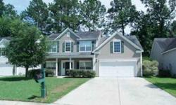 A full front porch greets you as you prepare to enter into this spacious and open floor plan! Lovely hardwoods grace the entryway and the formal dining room, which is large and should easily accommodate your dining room furniture. Enjoy the privacy of the