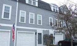 Fabulous opportunity to own this bright and airy three level townhouse in Adams Village. Open Living Room and Dining Room with hardwood floors. Updated kitchen with stainless steel appliances and granite countertops. Master bedroom with walk-in