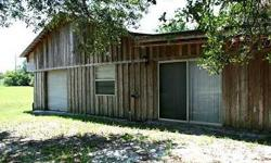 This 1 bedroom, 1 bath, 1 car garage home is located in Hudson, Florida. The property is situated on a corner lot that is MOL 6.89 acres located at the intersection of Hudson Avenue and Dream Oak Drive. The home has clay tile flooring throughout all