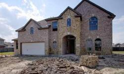 The Barcelona - Elevation B dressed in beautiful brick & Stone! Grand entry w/8ft Entry Door leads to an Impressive 18ft Rotunda Foyer, Open Wrought Iron Staircase! Tile Floors! Oil Rubbed Bronze Lighting/Fixtures, Chefs dream gourmet kitchen w/Avalon