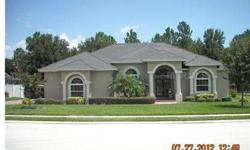 """This home shows like a model! Beautiful from the front door to the """"bonus"""" room which is ideal for the man of the house. Split plan, formal living and dining with hardwood floors-Kitchen features beautiful cherry cabinets-granite counters, top of the line"""