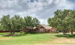 Perfect for Entertaining Indoor or Out. Large Kitchen,island,double oven with convection. Large decking around pool and outdoor grill. Granite countertops in kitchen and master bath. Wood flooring in dining and living, ceramic tile in kitchen, travertine