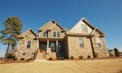 Woodfin Ridge Golf Community! All brick 3 bedroom, 2.5 bath plus huge bonus room, complete with all the upgrades you have come to expect from luxury living. Located on a premium lot overlooking the green, the front entrance is granted with beautiful