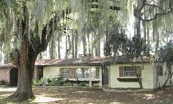 Lake Eustis Frontage. What an opportunity to own nearly 3/4 of an acre directly on Lake Eustis. Sit on the dock and watch the sunsets and the sailboats. This home has room to grow and endless possibilities situated on a lot of giant cypress trees. The