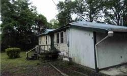 +/-980sqft Home on 0.80ac lot in Summerville. 2 bedrooms/ 1 bath. Family room has built in entertainment center- space for TV in the center, cabinets and shelves on either side/ hardwood floors. Previous owners started repairs in bathroom, kitchen,