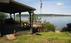 Anderson Island Waterfront Cabin with 90ft of Sound beach frontage on Amsterdam Bay; large boathouse, RV Port, and tool shed. Quaint cinder block & cedar siding, concrete floor. Newly refinished