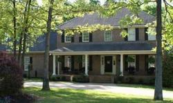 Lots more pics at www.309fishermanscove.com This home is located in the beautiful upscale and convenient Lake Emory subdivision. Level park-like .58 acre lot has a circle drive and lots of shade trees. The large front porch will welcome your guest and the