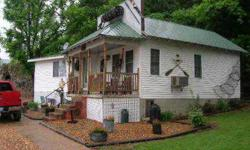 Reduced $50,000!!! Below apprasial! Make offer!for sale 4 very nice river front cabins minutes from lake of the ozarks, missouri. Listing originally posted at http