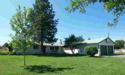 This west-side country home is located on 3 irrigated acres at the end of a quiet cul-de-sac, just a few minutes from town. The bright and open kitchen sits adjacent to the dining room with the living and family rooms just around the corners. 4 bedrooms,