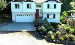Spectacular views from both the upstairs and downstairs from this 1756 sq ft home on Camano Island. Upstairs you will find the living room, kitchen with new laminate floors, mostly updated SS appliances and dining room. Walk down the hall to find bedroom