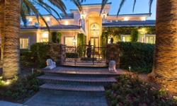 Grand Masterpiece in Tournament HillsList Price $2,850,000 | 9,200 Square Feet | 5 Bedrooms | 8 BathsAn elegant and luxurious home in prestigious Tournament Hills overlooking the 7th Fairway, with spectacular golf course and mountain views. This grand