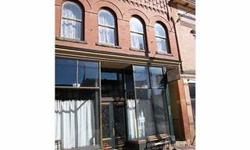 Own a piece of history! This updated stone building in the resurgent Victor business district has great potential. Updated throughout. Six bedrooms in upper level apartment. Two bedrooms on first floor. Live upstairs and work downstairs. Lost of options