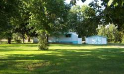 Nice older double wide on 1.1 acre, highway frontage and just 1 mile to access of Norfork Lake. Land is all level with nice trees, split rail fenced and gated for privacy and security. Awesome views of the countryside. 2 bedroom 1 bath with large