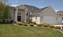 Fantastic 2 story home in very sought after Idaho Falls neighborhood. Located in the center of town - close to shopping, health care, schools, restaurants, this spacious home features a grand entry with soaring 2 story ceiling, nice living area with tons