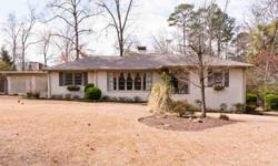 Welcome to this charming 1 level painted brick home located on a quite street in Vestavia. This property boast a 1+ acre flat lot that gives you lots of room to play, entertain or make an addition. Step onto the front porch and into the foyer that leads
