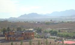 2.5 acres up in the hills overlooking Las Vegas and the Strip off of Lake Mead towards Lake Las Vegas. Surrounded by 1+ acre homes. Even if you build a one story home you will have great views with this lot. You can even build two dream homes with views