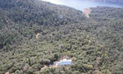 40.85 Acres of rolling, heavily treed mountainous property just above the base of the Sacramento Valley. Your everyday unobstructed views from the wall of windows & expansive decking include natural landscaping surrounded by a spectacular panoramic view