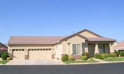 55+ Community. This Summer Breeze model has a enclosed patio made into an Entertainment room. The square footage increases to 2130sf. New tile and carpeting. Custom Oak kitchen with eating area at large counter. ALL Appliances are STAYING with the Home!
