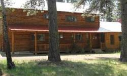 Lovingly maintained log home on two levels with Great Room, spacious cooks kitchen. An approximate 2,300 square foot detached shop, abundant storage for RV, recreation vehicles, sun decks. Surrounded by towering pines for the ultimate, private setting