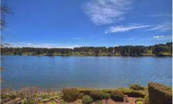 Don't miss the best waterfront in Mason County. This Low Bank/Medium Bank bulkhead w / Sandy Beach, waterfront oasis has it all, approx. 4 acres professionally landscaped with Ample room to entertain inside and out with expansive decking, sprinkler