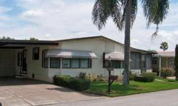 A fully furnished and move in ready 2br/2ba home. This is a 1989, Homes of Merit with 1352sf of living space not including the spacious, glass enclosed FLR with a portable a/c. The home is decorated in serene pastel colors and it has an oversized LR with
