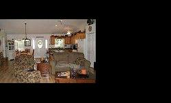 """LAKEFRONT """"Mother-in-Law"""" HOME! Located on shores of crystal-clear Clinch Lake, this home offers 3 bedrooms & 2 baths in the main home with a split bedroom plan. There is a great room open to living/dining/kitchen. The kitchen comes equipped with ALL"""