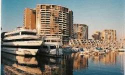 Beautiful Marina City Club! Walls of glass capturing a stunning northern coastline view. With hardwood floors and updated kitchen, this open floorplan has a great feel. All inclusive amenity complex includes tennis courts, pools, security, two car