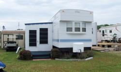 07 Bayridge Park model Trailer Model FKS 38 -- Like new condition 38' with front and rear slide outs. Eight foot ceilings, ceiling fans. Full front kitchen, with full size refrigerator, 4 burner stove, and oven, over the range microwave, vent fan, double