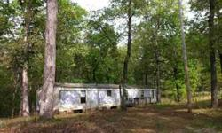 Huge corner lot, 2.4 acres, close to all Pickwick has to offer. Manufactured home can be a fixer upper or build your own weekend place on this great piece of land! Priced to sell! Listing originally posted at http