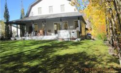 """One of a kind custom cuilt """"barn"""" style home set on 2 full lots, nicely landscaped with trees surrounding for privacy. Great quiet community in Westcove, off the shores of Lac Ste Anne. This 3 bedroom home with loft is absolutely immaculate inside and"""