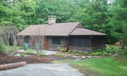This log home is in beautiful condition and comes with lake access and deeded mooring. Includes 2 bedrooms, cathedral ceiling with wood interior walls and floor to ceiling fireplaces, updated bath, 3-season porch, slate patio, nicely landscaped with rain