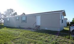 This 2011 Champion 16X70 home is move in ready and still feels like new! You will not be disappointed in this mobile home. The home offers 3 bedroom and 2 full baths with an open kitchen, eat in area, and living area. Located in Cottonwood Village Lot