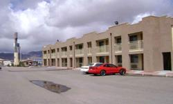 117 UNIT MOTEL LOCATED AT THE ANDY DIVINE SOUTH OFFRAMP OF THE INTERSTATE 40 FREEQAY IN KINGMAN, AZ. 4.27 PRIME ACRES SUITABLE FOR A VARIEY OF USES IN ADDITON TO, OR AS A REPLACEMENT FOR THE CURRENTLY OPERATION HOTEL ON SITE. CUSSRENT HOTEL IS