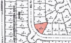Wow, such a deal on this Anderson island lot. Priced below assessed value. 10,000 sq. ft. level lot ready to build your island escape. Optoin to buy adjoining lot available from seller. Ownership includes all the Riviera Community has to offer