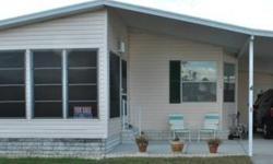 This is a very nice and bright 1993 doublewide for $40,000 with 2/2 and 1200 SqFt. It comes semi-furnished with washer, dryer, dishwasher, oven, and other appliances. The roof is no more then 1 year old, it has a carport, shed, and nice landscaping. Pool