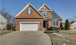 Beautiful two level all brick home with ground floor owner's suite!