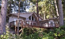 Beautifully transformed Lakefront chalet on Lake Josephine. This home features 2 bedrooms, 2 full baths, loft (3rd bedroom), spacious and gorgeous kitchen, huge master suite with walk-in closet, dining room and a deck everyone dreams of. Home was recently