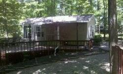 Like New !! Excellent Condition!!Owner will consider all trades! 2005 Top of the line Breckenridge Park Model in Quiet wooded setting close to surrounding state parks and minutes from Brookville Lake. This lot is larger than normal with a creek running