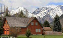You can't beat the mountain views from this large home on an acre just minutes from downtown Leavenworth. Come find out why the Icicle Meadows Lodge has been such a popular vacation rental year after year. Listing originally posted at http