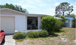 Short sale fantastic buy in holiday, oversized garage, no flood insurance required, sliders open to screened patio & nearby bbq area, enclosed yard, bonus room, large master bedroom, all appliances convey, roof just ten years old, newer windows, shed -