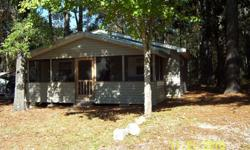 Cabin on The Choctawatchee River In Florida. Furnished 2 bedroom cabin for sale. Has a screened in porch with vinyl siding. 780 sq ft. Walking distance of boat ramp. Located between Ebro and Panama City Florida, at Simplers Fish Camp in Bruce FL 32455.