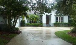 6/15/2012 NESTLED IN A CANOPY OF STATELY OAK TREES AND LOCATED ON THE 13TH FAIRWAY OF THE HERON GOLF COURSE IS A UNIQUELY DESIGNED SANCTUARY FOR ENTERTAINING OR QUIET ENJOYMENT. This delightful home is designed to accommodate two lifestyles. Enjoy casual