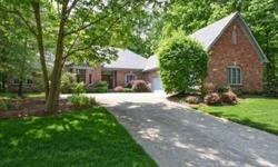 Custom built all brick ranch on wooded 1 acre lot. Basement is finished w/ massive amounts of storage space. Great room w/15 ft ceiling and bank of windows that overlook private backyard, Formal DR w/tray ceiling, Library w/floor to ceiling cherry