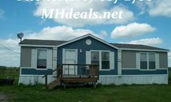 $47,900A 2013 Cavco doublewide manufactured home in cedar creek, TX. A massive 32x44 with 3 bedroom and 2 bathrooms, the home is all electric. The exterior has a hardboard siding with shingle roofing. The Master Bathroom has a Large Walk In Shower. There