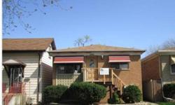 Great Opportunity. Spacious Brick 2 Units located in Stone Park. This lovely house features