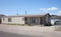 Great vacation place or a starter home with plenty parking and a garage. Lots of rooms with a big living room and additional family room. The roof was replaces just a few years ago. Close to the River, shopping, banking, Rotary Park and to public boat