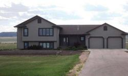 Custom home and huge shop on 5 acres! Built by Reyelts in 2000 this home features 2 x 6 exterior walls, large attached garage with floor drain, sink and 8' overhead doors, partial dryvit exterior, Pella windows and Riss cabinetry, 2 natural gas furnaces,